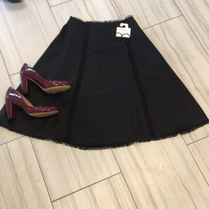 TSE mid length black skirt size 6